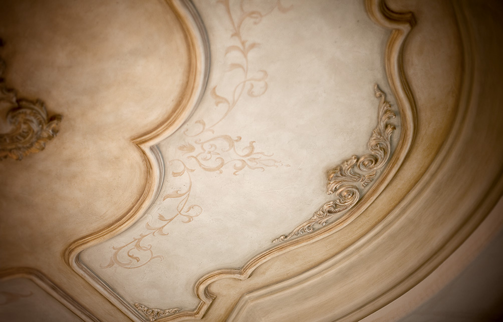 Hand painted Design and custom moldings in dining room ceiling.